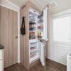 Как можно встроить обычный холодильник в кухонный шкаф